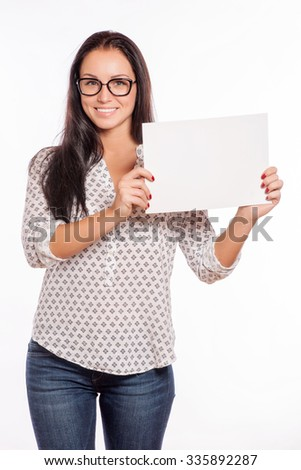 Portrait of cheerful beautiful woman showing blank signboard with copyspace area for text or slogan