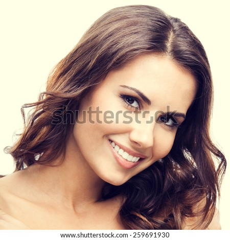 Portrait of cheerful beautiful young woman - stock photo