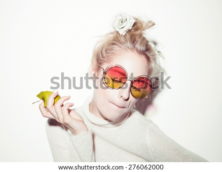 portrait of cheerful blonde hipster girl going crazy making funny face - stock photo