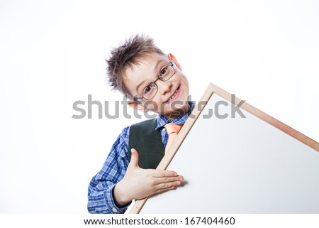 Portrait of cheerful boy pointing to banner on the white background