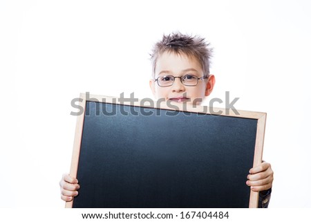 Portrait of cheerful boy pointing to banner on the white background - stock photo