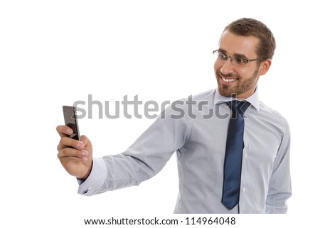 Portrait of cheerful business man with eyeglasses taking photos with phone camera over white background.