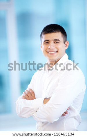 Portrait of cheerful businessman looking at camera - stock photo