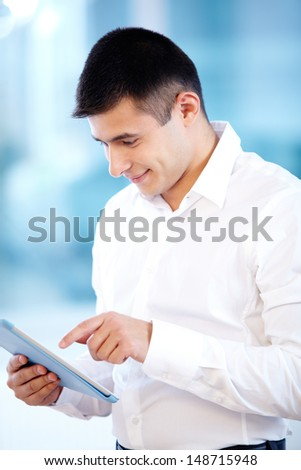 Portrait of cheerful businessman working with touchpad - stock photo