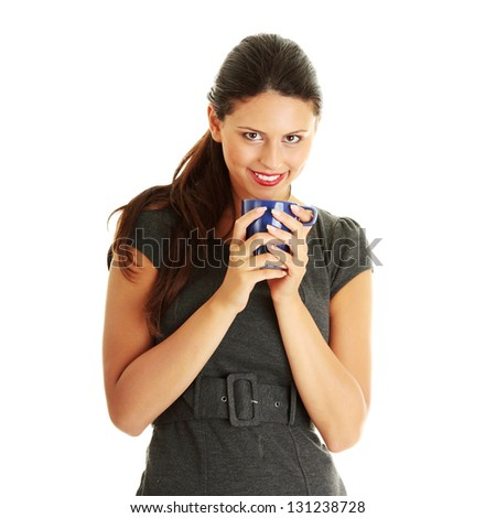 Portrait of cheerful businesswoman holding coffee cup against white background