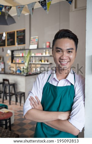 Portrait of cheerful cafe owner