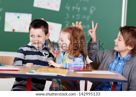 Portrait of cheerful children having fun at the classroom