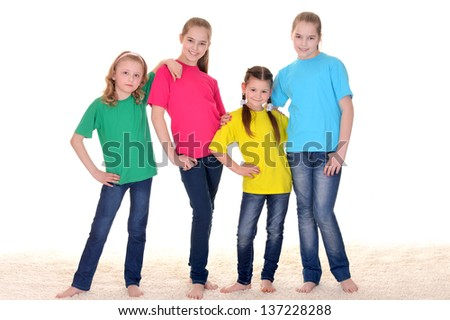 Portrait of cheerful children in colorful t-shirts on white background - stock photo