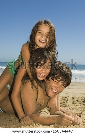 Portrait of cheerful children playing on beach