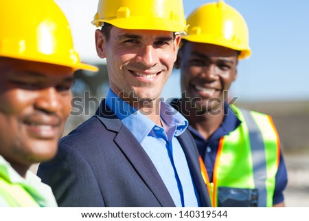 portrait of cheerful construction engineers - stock photo