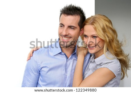 Portrait of cheerful couple looking away - stock photo