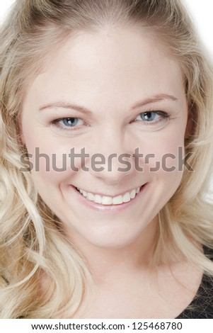 Portrait of cheerful face of a woman - stock photo