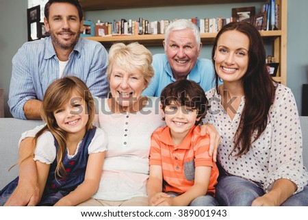Portrait of cheerful family with grandparents at home