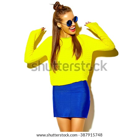 portrait of cheerful fashion hipster girl going crazy  in casual colorful hipster yellow summer clothes with red lips isolated on white