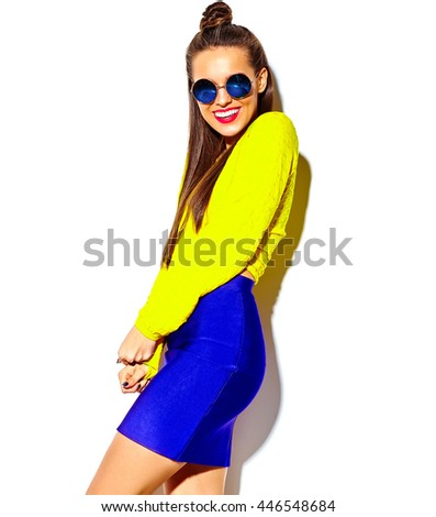 portrait of cheerful fashion smiling hipster girl going crazy in casual colorful yellow summer clothes with red lips isolated on white