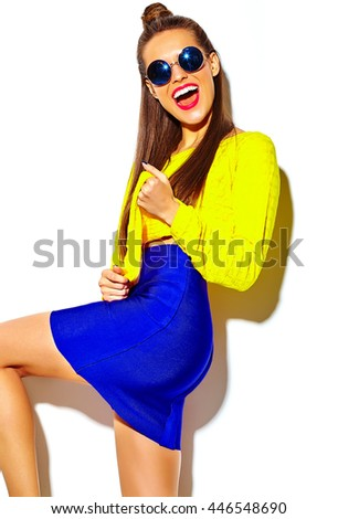 portrait of cheerful fashion smiling hipster girl going crazy in casual colorful yellow summer clothes with red lips isolated on white  - stock photo