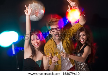 Portrait of cheerful friends clubbing together