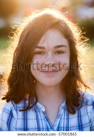 Portrait of cheerful girl outdoor - stock photo