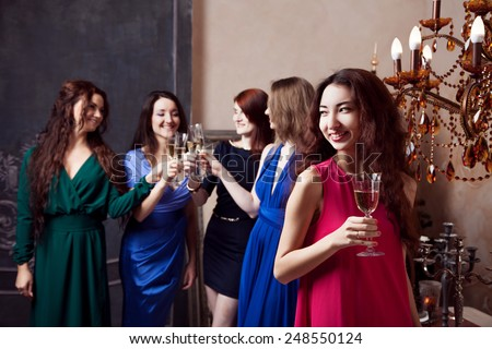 Portrait of cheerful girl with champagne - stock photo