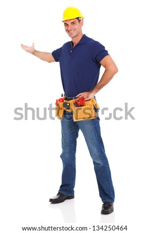 portrait of cheerful handyman presenting over white background