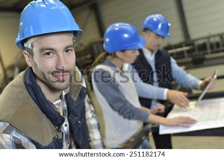 Portrait of cheerful industrial engineer
