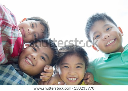 Portrait of cheerful kids smiling at the viewer - stock photo