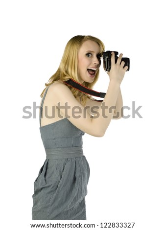 Portrait of cheerful lady while taking picture against white background