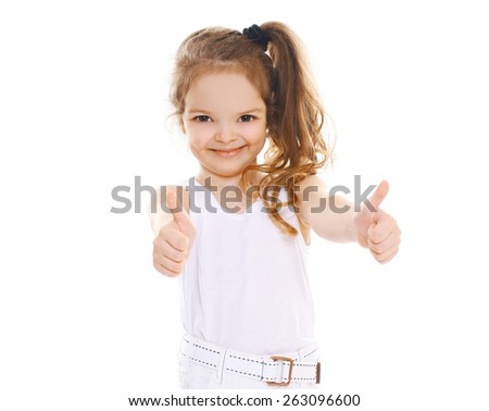 Portrait of cheerful little girl showing thumbs up - stock photo