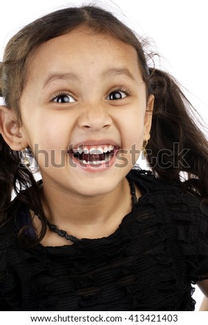 Portrait of cheerful little Indian girl