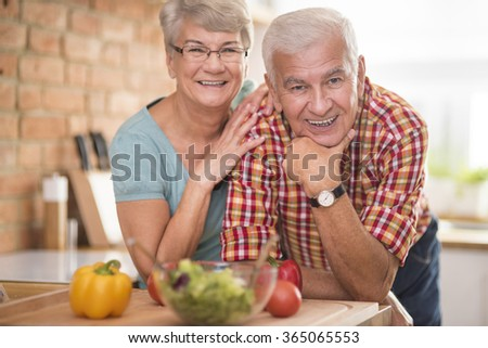 Portrait of cheerful marriage at the domestic kitchen