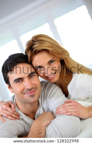 Portrait of cheerful middle-aged couple - stock photo