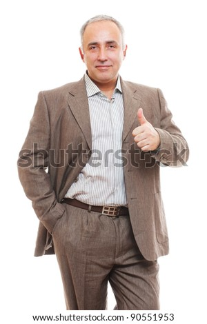 portrait of cheerful senior business man in suit showing thumbs up