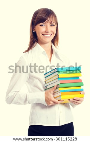 Portrait of cheerful smiling student or young businesswoman with textbooks - stock photo