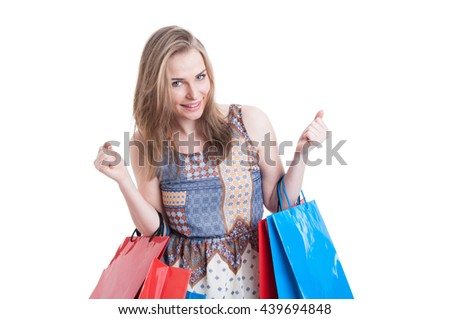 Portrait of cheerful smiling woman with shopping bags looking excited and acting like a winner isolated on white background - stock photo