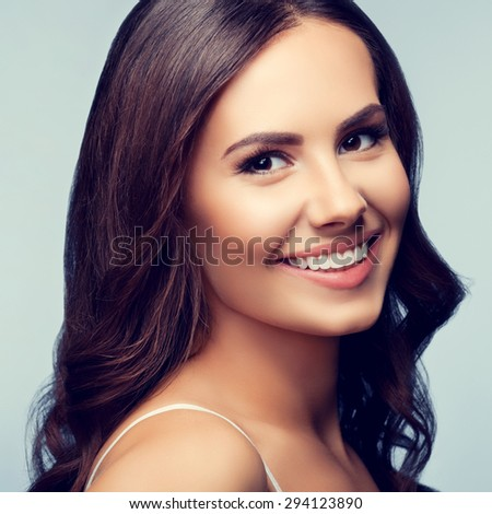 Portrait of cheerful smiling young lovely brunette woman