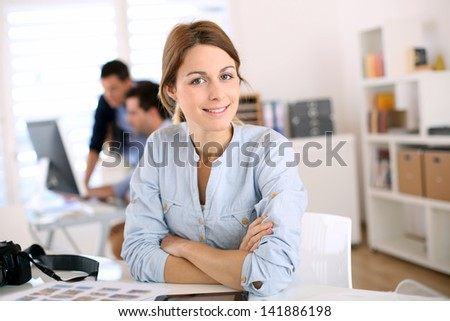 Portrait of cheerful student in communication - stock photo