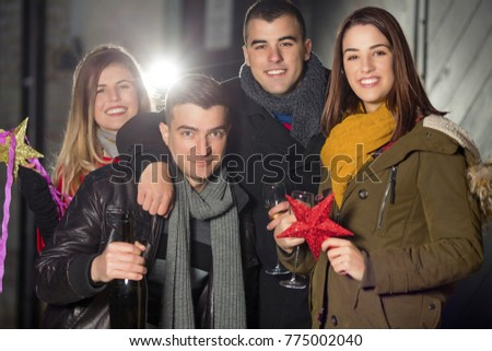 Portrait of cheerful teenage friends having fun together