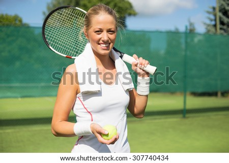 Portrait of cheerful tennis player