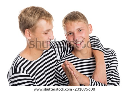 Portrait of cheerful two twin brothers, close up. The guys at the age of eighteen.  - stock photo