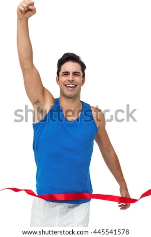Portrait of cheerful winner athlete crossing finish line with arms raised on white background - stock photo