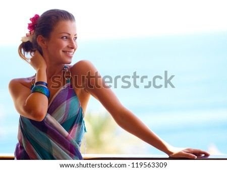 Portrait of cheerful woman enjoying sun and sea at beach