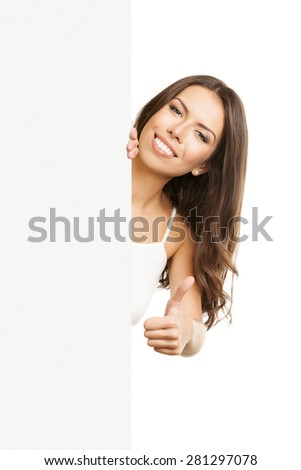 Portrait of cheerful woman in tank top casual smart clothing, showing thumb up hand sign gesture, over empty blank signboard with copyspace area for text or slogan, isolated on white background - stock photo