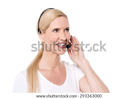 Portrait of cheerful woman with headset - stock photo