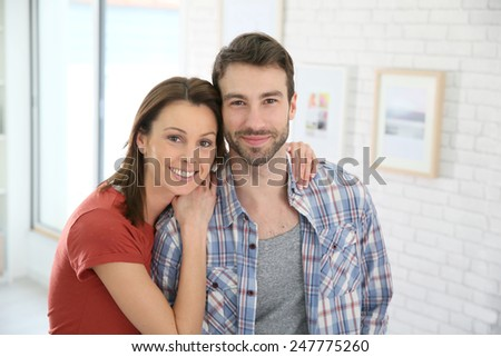 Portrait of cheerful 30-year-old couple  - stock photo