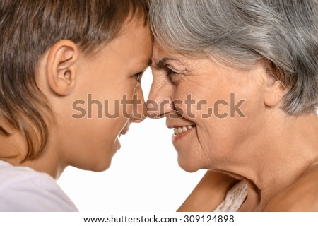 Portrait of cheerful young boy and his grandmother on a white background