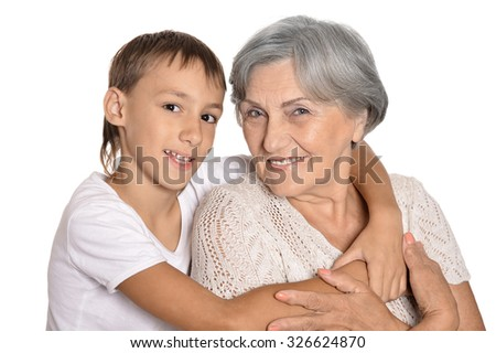 Portrait of cheerful young boy and his grandmother on a white background - stock photo