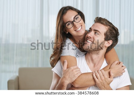 Portrait of cheerful young boyfriend and girlfriend in love - stock photo