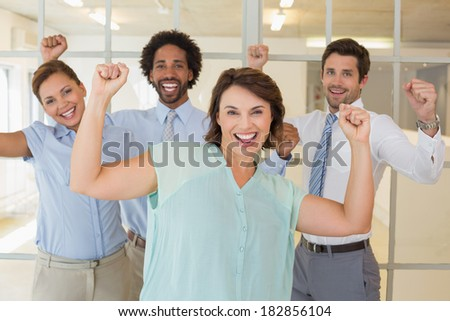 Portrait of cheerful young business colleagues cheering in the office - stock photo
