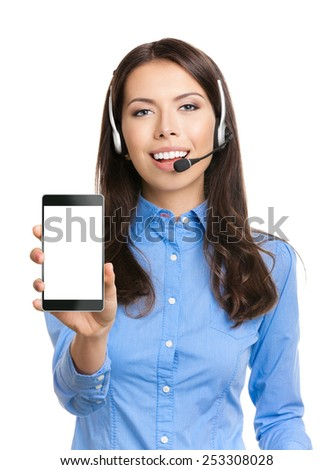 Portrait of cheerful young customer support phone operator showing blank no-name cellphone, isolated over white background - stock photo