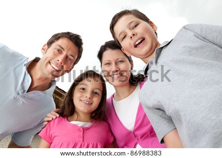 Portrait of cheerful young family together - Outdoors - stock photo